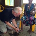 Treating a Kwaio woman's foot